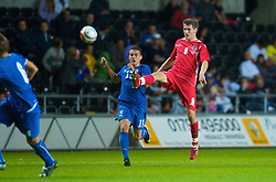 SWANSEA, ENGLAND - Friday, September 4, 2009: Wales' Aaron Ramsey and Italy's Antonino Barilla during the UEFA Under 21 Championship Qualifying Group 3 match at the Liberty Stadium. (Photo by David Rawcliffe/Propaganda)
