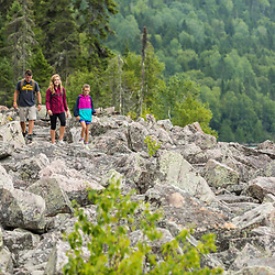 A man and his two daughters hike on the Loop Trail next to Deboullie Pond in Aroostook County, Maine. Deboullie Public Reserve Land.