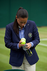 LONDON, ENGLAND - Wednesday, July 3, 2019: An umpire checks the new tennis balls during the Ladies' Singles second round match on Day Three of The Championships Wimbledon 2019 at the All England Lawn Tennis and Croquet Club. (Pic by Kirsten Holst/Propaganda)