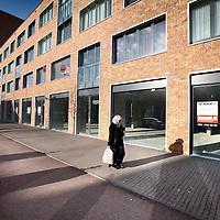 Nederland, Amsterdam , 10 maart 2011..Lege winkelpanden aan de Ijburglaan  951 t/m 961...Foto:Jean-Pierre Jans
