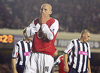 20/11/2004 - FA Barclays Premiership - Arsenal v  - West Bromich Albion - HIghbury Stadium, London<br />Arsenal defender Pascal Cygan holds his face after missing a golden chance with a free header that he sent over the bar.<br />Photo:Jed Leicester/Back Page Images