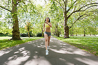 Full length of determined fit woman jogging at park
