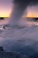 Steam boils out of Fountain Geyser at sunset, Fountain Paint Pot area, Yellowstone National Park, MONTANA