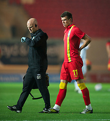 LLANELLI, WALES - Wednesday, August 15, 2012: Wales' Gareth Bale walks off injured with physiotherapist Sean Connelly during the international friendly match against Bosnia-Herzegovina at Parc y Scarlets. (Pic by David Rawcliffe/Propaganda)