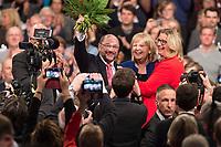 19 MAR 2017, BERLIN/GERMANY:<br /> Martin Schulz (L), SPD, mit Blumen nach seiner Wahl zum SPD Parteivorsitzenden und SPD Spitzenkandidat der Bundestagswahl, mit Hannelore Kraft (M), SPD, Ministerpraesidentein Nordrhein-Westfalen, und Anke Rehlinger (R), Spintzenkandidtain SPD Saarland, a.o. Bundesparteitag, Arena Berlin<br /> IMAGE: 20170319-01-081<br /> KEYWORDS: party congress, social democratic party, candidate, Jubel, Smartphone