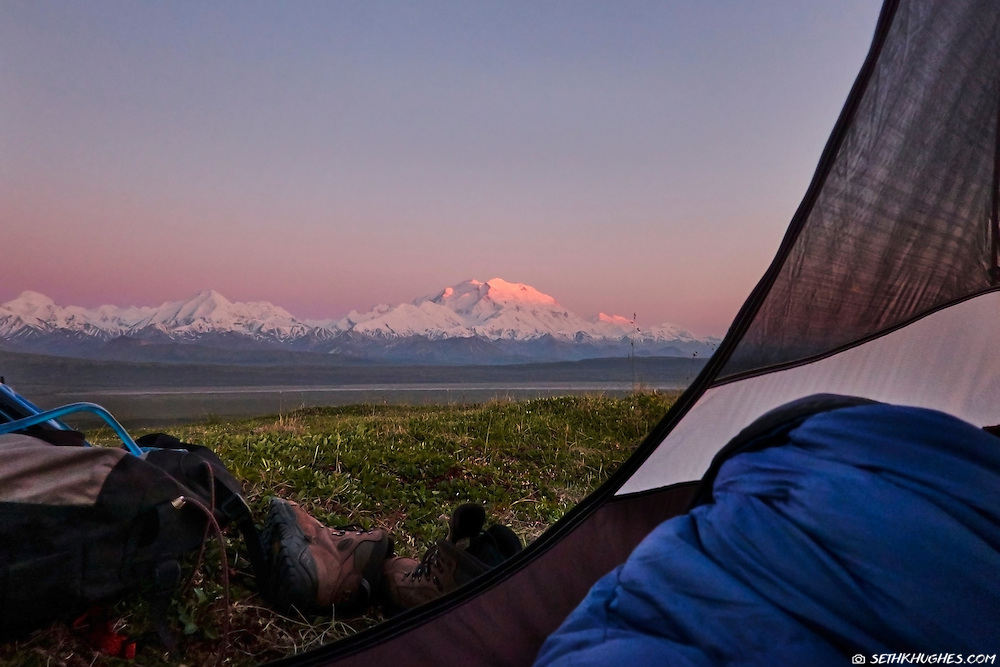 A view of Mt. McKinley through an open tent door while backcountry camping in Denali National Park, Alaska.
