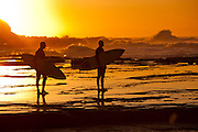 Surfers watching surf at Dawn, Susan Gilmore Beach, Newcastle, Australia