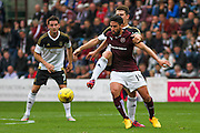 David Goodwille  attacks Miguel Pallardo during the Ladbrokes Scottish Premiership match between Heart of Midlothian and Aberdeen at Tynecastle Stadium, Gorgie, Scotland on 20 September 2015. Photo by Craig McAllister.