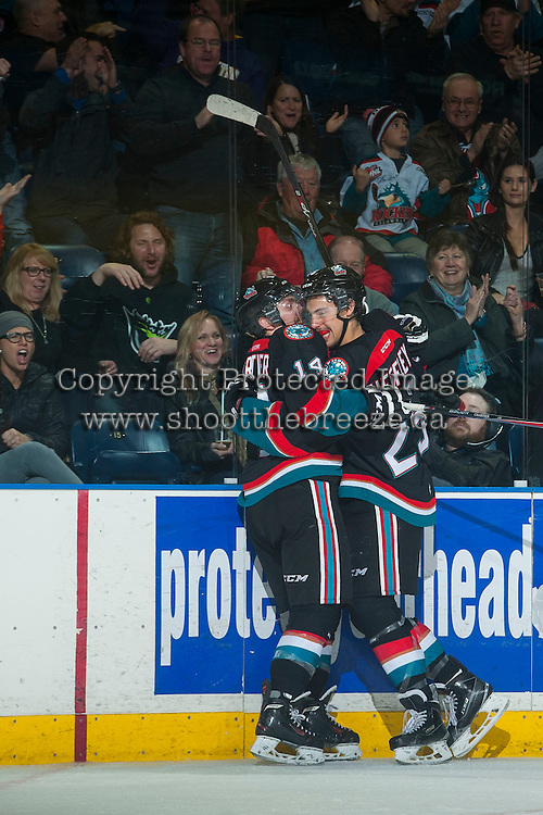 KELOWNA, CANADA - NOVEMBER 22: Rourke Chartier #14 celebrates a goal with Colton Heffley #25 of Kelowna Rockets during the third period against the Portland Winterhawks on November 22, 2014 at Prospera Place in Kelowna, British Columbia, Canada.  (Photo by Marissa Baecker/Shoot the Breeze)  *** Local Caption *** Rourke Chartier; Colton Heffley;