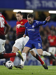 BRITAIN-LONDON-FOOTBALL-FA CUP-CHELSEA VS MAN UNITED.(190218) -- LONDON, Feb. 18, 2019  Manchester United's Nemanja Matic (L) vies with Chelsea's Eden Hazard during the FA Cup fifth round match between Chelsea and Manchester United in London, Britain on Feb. 18, 2019. Manchester United won 2-0. FOR EDITORIAL USE ONLY. NOT FOR SALE FOR MARKETING OR ADVERTISING CAMPAIGNS. NO USE WITH UNAUTHORIZED AUDIO, VIDEO, DATA, FIXTURE LISTS, CLUB/LEAGUE LOGOS OR ''LIVE'' SERVICES. ONLINE IN-MATCH USE LIMITED TO 45 IMAGES, NO VIDEO EMULATION. NO USE IN BETTING, GAMES OR SINGLE CLUB/LEAGUE/PLAYER PUBLICATIONS. (Credit Image: © Xinhua via ZUMA Wire)
