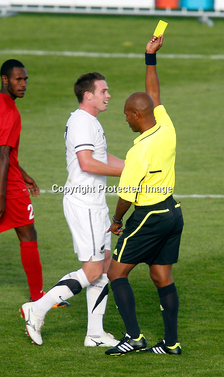 Referee Gerald Oiaka gives NZ's Adam McGeorge a yellow card. OFC Men's Olympic Qualifier New Zealand 2012, New Zealand v Papua New Guinea, Owen Delany Park Taupo, Friday 16th March 2012. Photo: Shane Wenzlick