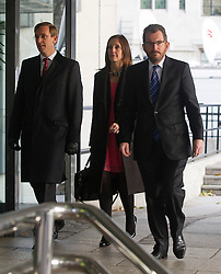 © London News Pictures. 29/11/2012. London, UK. L to R Counsel to the Inquiry David Barr, Carine Patry Hoskins and  Robert  Jay Q.C arriving at the QEII centre in London ahead of Lord Justice Leveson announcing his report  into the culture and ethics of the UK's press. Photo credit: Ben Cawthra/LNP