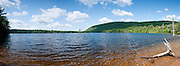 Adirondacks, NY.  It was breezy on this gorgeous morning, and behind me kayakers were getting ready to put in.  Days like this don't come often, and I took several shots before trying a vertical panorama which seemed to capture the lake better.