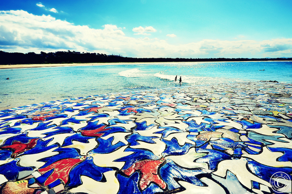 Scotts Head beach NSW Australia. Looking over a mosaique tile table onto the beach.