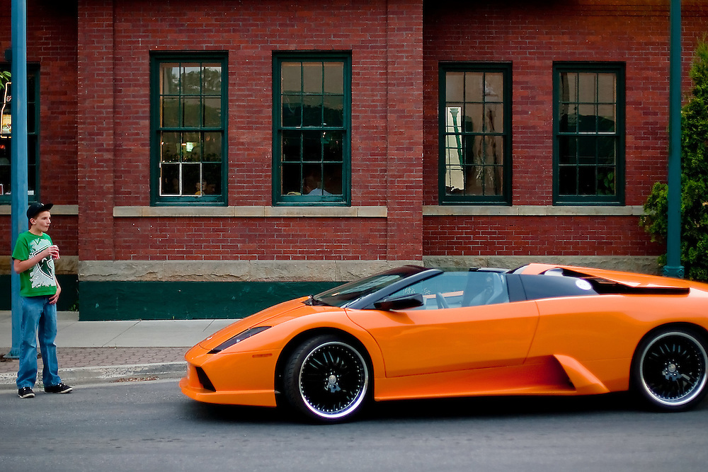 A teenager is captivated by a $350,000 Lamborghini Murcielago parked outside a restaurant during the annual Car d'Lane cruise held Friday.