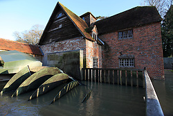 © Licensed to London News Pictures. 29/11/2012. Mapledurham, UK. The Archemedes screw thread turbine next to Mapledurham Watermill had to be turned off due to the flooding. Ironically, last October when installed and ready to use, there was not enough water to turn it on. The River Thames is flooded after several days of heavy rain. Photo credit : Rebecca Mckevitt/LNP