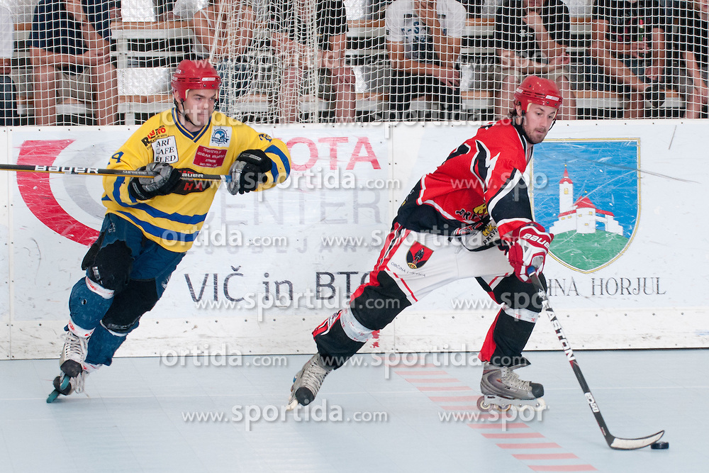 Ales Remar of HK Prevoje and Matevz Erman of Troha Pub Bled at final match of IZS Masters 2011 inline hockey between Troha Pub Bled and HK Prevoje, on June 4, 2011 in Sportni park, Horjul, Slovenia. (Photo by Matic Klansek Velej / Sportida)
