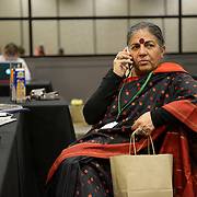 Dr. Vandana Shiva talks to a reporter on her cell phone from the International Women's Earth and Climate Summit. Leaders from 35+ countries gathered for the drafting of a Women's Climate Action Agenda in Suffern, New York September 20-23rd, 2013 as part of the International Women's Earth and Climate Summit.  For a full list of Summit delegates and an agenda visit www.iweci.org. Photo by Lori Waselchuk/Magazines OUT