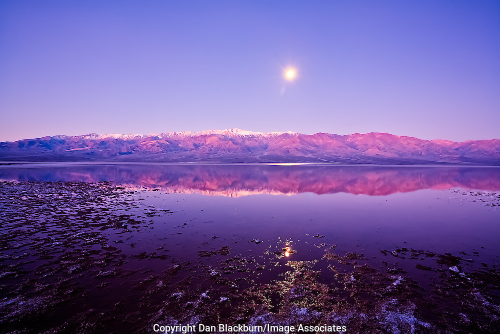 Moonrise and sunset over Telescope Peak, the Panamint Mountains and Badwater in Death Valley, California.
