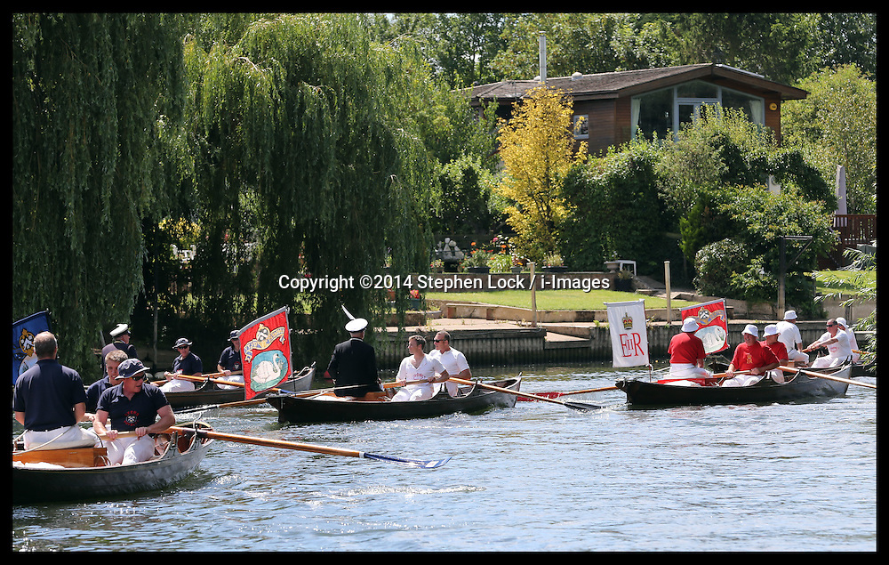 Image licensed to i-Images Picture Agency. 14/07/2014. Shepperton, United Kingdom.  Swan Uppers set off on the Swan Upping, the annual census of the swan population on the river Thames . Picture by Stephen Lock / i-Images