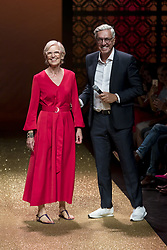 July 3, 2018 - Berlin, Germany - Fashion Designer Karin Veit (L) and label Founder Helmut Schlotterer (R) acknowledge the applause of the guests at the end of the Marc Cain Spring/Summer 2019 Fashion Show at Westhafen in Berlin, Germany on July 3, 2018. Chef of Design Karin Veit is leaving the label after 43 years. (Credit Image: © Emmanuele Contini/NurPhoto via ZUMA Press)