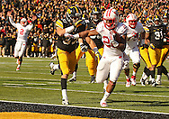 November 02 2013: Wisconsin Badgers running back James White (20) runs 11 yards for a touchdown during the second half of the NCAA football game between the Wisconsin Badgers and the Iowa Hawkeyes at Kinnick Stadium in Iowa City, Iowa on November 2, 2013. Wisconsin defeated Iowa 28-9.
