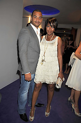 Michael Underwood and Anjelica Bell at The Ralph Lauren Sony Ericsson WTA Tour Pre-Wimbledon Party hosted by Richard Branson at The Roof Gardens on June 18, 2009