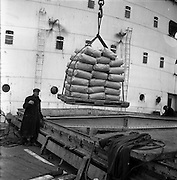 18/04/1962<br /> 04/18/1962<br /> 18 April 1962<br /> Irish sugar for USA<br /> A consignment of 1,600 tons of Irish beet sugar is loaded onto the S.S. Irish ELM at Dublin Docks on Wednesday, 18 April 1962. The sugar is bound for New York and Baltimore, Maryland, USA.