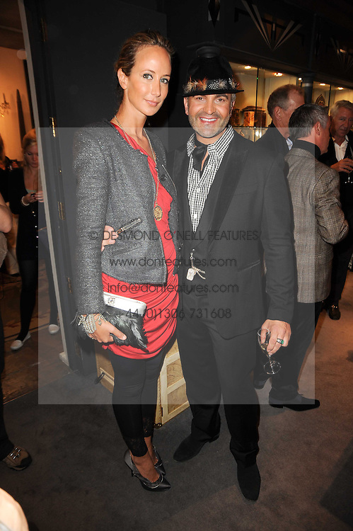 LADY VICTORIA HERVEY and MARTYN LAWRENCE BULLARD at an exclusive viewing of Martyn Lawrence Bullard's furniture at Guinevere Antiques, 578 King's Road, London on 27th September 2010.
