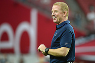 GLENDALE, AZ - SEPTEMBER 25:  Head coach Jason Garrett of the Dallas Cowboys smiles on the field prior to the NFL game against the Arizona Cardinals at University of Phoenix Stadium on September 25, 2017 in Glendale, Arizona.  (Photo by Jennifer Stewart/Getty Images)