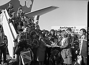 Irish Paralympic Team Arrive Home From Seoul.(R89).1988..28.10.1988..10.28.1988..28th October 1988..The Seoul Summer Paralympics 1988..The very successful Irish Paralympic team arrived home to Dublin today. The team managed a haul of 42 medals, 13 Gold, 11 Silver, 18 Bronze which earned them 19th place in the overall medal table...Eileen Lemass TD is pictured with the Irish Paralympic team as they proudly display their hard won medals.