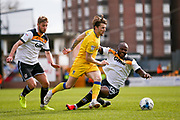 AFC Wimbledon midfielder Jake Reeves (8) goes past Port Vale forward Andre Bikey (39)  during the EFL Sky Bet League 1 match between Port Vale and AFC Wimbledon at Vale Park, Burslem, England on 1 April 2017. Photo by Simon Davies.