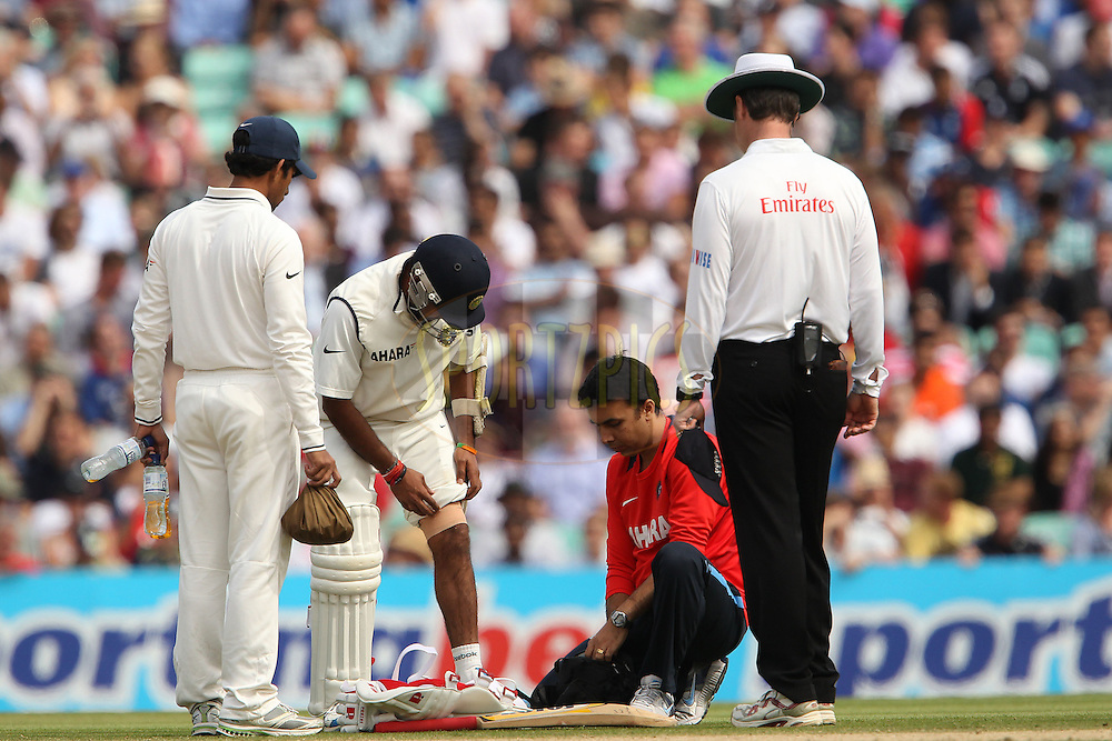 India's Amit Mishra receives treatment during day 5 of the fourth test match between England and India held at The Oval in Lambeth, London, England on the 22nd August 2011...Photo by Ron Gaunt/SPORTZPICS/BCCI