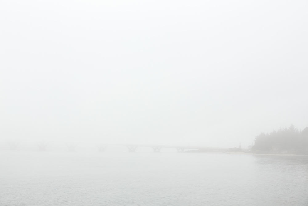 Alsea Bay Bridge through the fog near Waldport, Oregon.
