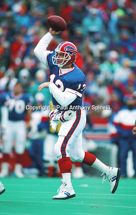 Buffalo Bills quarterback Jim Kelly (12) throws a pass during the NFL football game against the Denver Broncos on Dec. 12, 1992 in Orchard Park, N.Y. The Bills won the game 27-17. (©Paul Anthony Spinelli)
