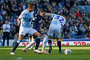 Leeds United midfielder Pablo Hernandez (19) battles with Blackburn Rovers Jack Rodwell and Blackburn Rovers Craig Conway  during the EFL Sky Bet Championship match between Blackburn Rovers and Leeds United at Ewood Park, Blackburn, England on 20 October 2018.