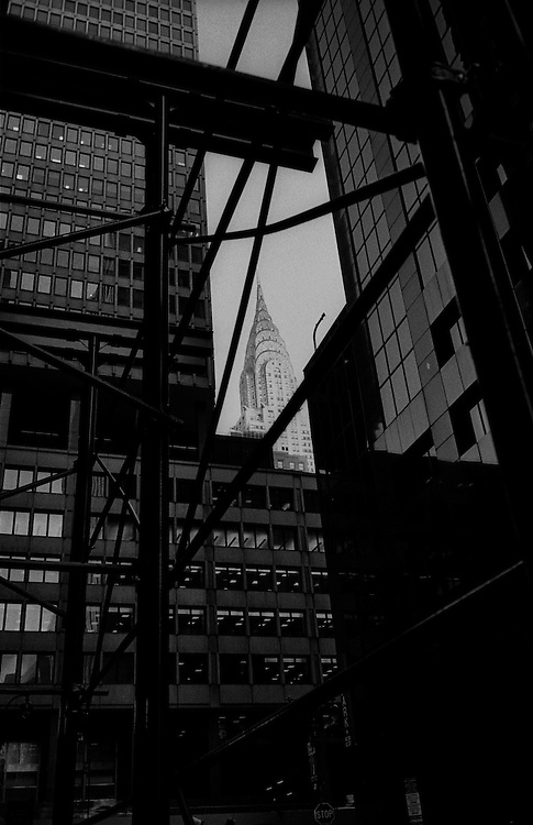 "Chrysler Building seen through buildings and scaffolding near Grand Central Station...Part of long-term (2005-2008) story ""I See A Darkness"". New York, NY."
