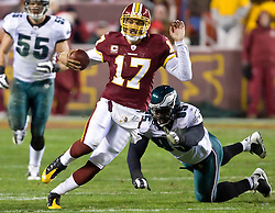 Washington Redskins quarterback Jason Campbell (17) scrambles up field, evading a tackle by Philadelphia Eagles defensive end Victor Abiamiri (95).  The Washington Redskins defeated the Philadelphia Eagles 10-3 in an NFL football game held at Fedex Field in Landover, Maryland on Sunday, December 21, 2008.