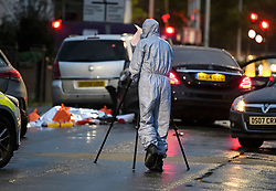 © Licensed to London News Pictures. 11/10/2018. London, UK.  Police forensics at the scene in Hayes where a man was found shot dead after the Mercedes car he was in collided with other vehicles near the Uxbridge Road in Hayes. The victim died at the scene.  Photo credit: Ben Cawthra/LNP