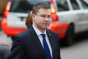 Valdis Dombrovskis, Prime Minister of Latvia, arrives at a EU Budget summit at the European Council building after a break in Brussels, Friday, Feb. 8, 2013. A European Union summit to decide EU spending for the next seven years entered a second day after all-night negotiations left a standoff over spending unresolved. The leaders of the 27 nations inched toward a compromise Friday that would leave their common budget with a real-term cut for the first time in the EU's history.