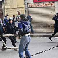 Demonstrators clash with Egyptian riot police following Friday prayers in Islamic Cairo, Egypt. January 2011.