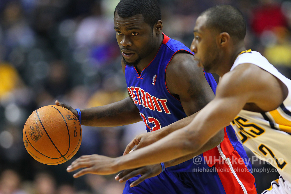 Feb. 23, 2011; Indianapolis, IN, USA; Detroit Pistons point guard Will Bynum (12) dribbles against Indiana Pacers guard Darren Collison (2)  at Conseco Fieldhouse. Indiana defeated Detroit 102-101. Mandatory credit: Michael Hickey-US PRESSWIRE