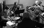 Jeremy Gibson, left, Kimi Samson, second from left, Caleb Elliott, right,  and Dylan LeBlanc, center, practice Monday in Florence. Gibson and Elliott recently moved from Louisiana to do studio work and back LeBlanc. Samson, who has lived here since 2002, plays violin in studio and for a variety of bands in the Shoals.