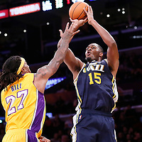 19 October 2014: Utah Jazz center Derrick Favors (15) takes a jump shot  over Los Angeles Lakers forward Jordan Hill (27) during the Los Angeles Lakers 98-91 victory over the Utah Jazz, in a preseason game, at the Staples Center, Los Angeles, California, USA.