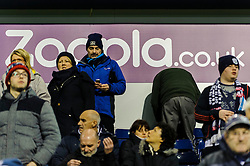 Fans stand in front of a sign inside the ground with Zoopla branding on the day the club sponsor announce they won't be renewing their deal after the 2013/14 season because of Nicholas Anelka's controversial Quenelle gesture. - Photo mandatory by-line: Rogan Thomson/JMP - Tel: Mobile: 07966 386802 - 20/01/2014 - SPORT - FOOTBALL - The Hawthorns Stadium - West Bromwich Albion v Everton - Barclays Premier League.