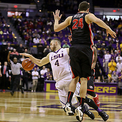 Jan 26, 2016; Baton Rouge, LA, USA; Georgia Bulldogs forward Houston Kessler (24) fouls LSU Tigers guard Keith Hornsby (4) during the second half of a game at the Pete Maravich Assembly Center. LSU defeated Georgia 89-85. Mandatory Credit: Derick E. Hingle-USA TODAY Sports