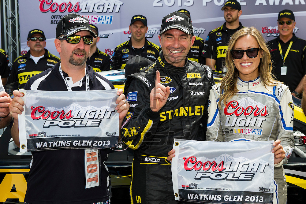 Watkins Glen, NY - AUG 10, 2013: Marcos Ambrose (9) wins the Coors Light Pole Award for the Cheez-It 355 at The Glen at the Watkins Glen International in Watkins Glen, NY.