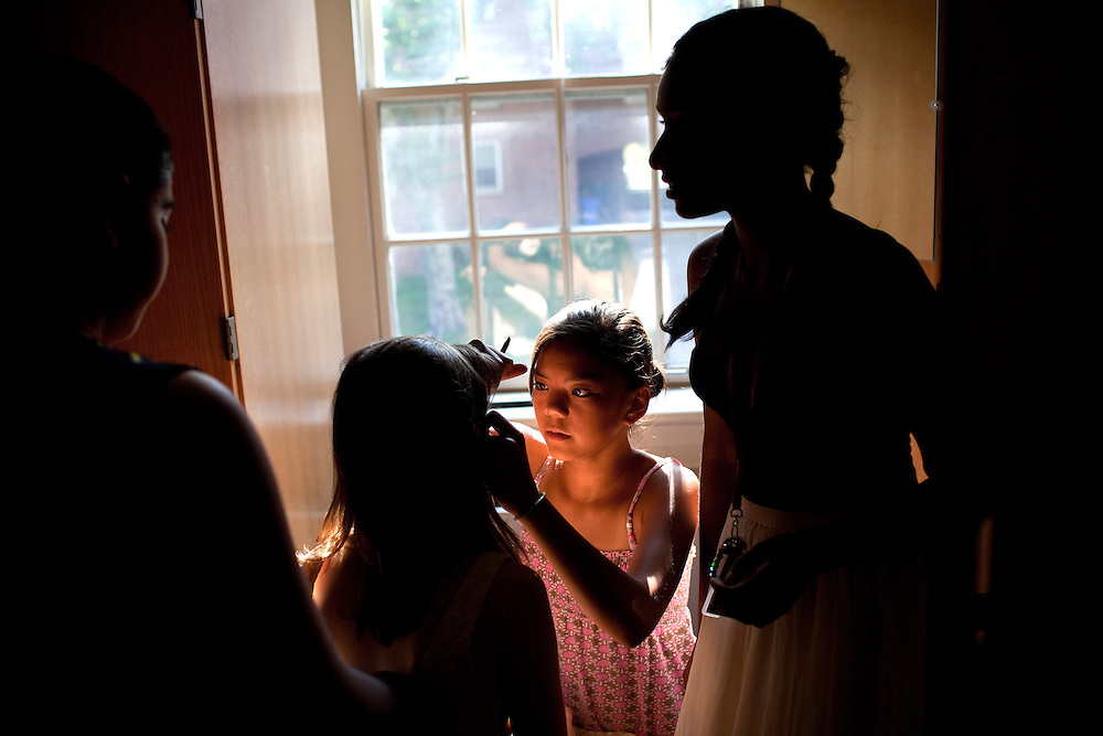 From left: Simran Malhotra, Abigail Melton, 15, Lily Chu, 13, and Jayna Viswalingam, 14, put on make-up in their dorm in preparation for the evening's Masquerade Ball at the Center for Talented Youth summer program at Lafayette College in Easton, PA on July 06, 2012. Several students were part of the Rural Connections scholarship program being offered for the first time this year.