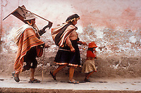 Blind harpist being led by his wife and daughter through the streets of Cusco, Peru