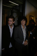 Ty Wood and Ronnie Wood, Ronnie Wood: Josephine - private view , Scream, 34 Bruton Street, London, W1. 29 March 2007. Rolling Stones  guitarist celebrates 22 years of marriage with exhibition of 60 oil paintings and watercolours of his wife.  -DO NOT ARCHIVE-© Copyright Photograph by Dafydd Jones. 248 Clapham Rd. London SW9 0PZ. Tel 0207 820 0771. www.dafjones.com.